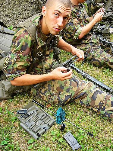 Cute_soldiers_cleaning_gun