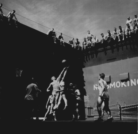 Gerald_Ford_playing_basketball_on_USS_Monterey_06-1944-Darkened_Larger